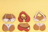Funny bikini underwear shape gingerbread cakes cookies on yellow — Stock Photo
