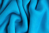Blue background abstract cloth wavy folds of textile texture — Stock Photo
