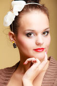 Portrait young beautiful  girl retro style make-up and hair bun — Stock Photo
