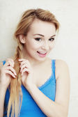 Hairstyle. Blond woman teenage girl plaiting braid hair. — Stock Photo