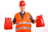 Man worker in safety vest and hard hat with canisters — Stock Photo