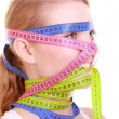 Stock Photo: Obsessed fitness womwith lot of colorful measure tapes