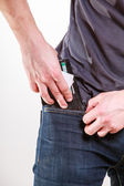 Closeup. Careless man putting wallet in his pocket. Theft. — Stock Photo