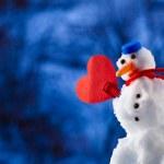 Little happy christmas snowman heart love symbol outdoor. Winter season. — Stock Photo