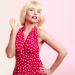 Portrait beautiful girl in blond wig and retro red dress. Vintage. — Stock Photo #42634515
