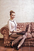 Business woman using computer. Internet home technology. Vintage photo. — Стоковое фото
