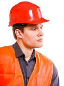 Man worker in safety vest and hard hat. Safety in work. — Stock Photo