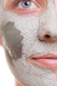 Skin care. Woman applying clay mask on face. Spa. — Stock Photo