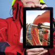 Man sailor showing lifebuoy on tablet. Sailing — Photo