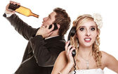 Wedding. Angry bride and groom talking on phone — Stock Photo