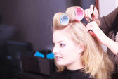 Beautiful blond girl hair curlers rollers hairdresser beauty salon — Stockfoto
