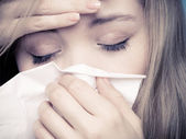 Flu fever. Sick girl sneezing in tissue. Health — Stock Photo