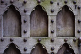 Architecture. Closeup of wooden door with rivets as background — Foto de Stock