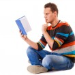 Male student reading a book preparing for exam isolated — Stock Photo