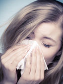Flu allergy. Sick girl sneezing in tissue. Health — Stock Photo