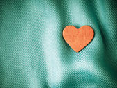 Valentine's day background. Red heart on blue folds cloth — Stock Photo