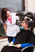 Woman dying hair in hairdressing beauty salon. Hairstyle. — Stock Photo