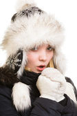 Winter vacation. Freezing girl warming her hands. — Stock Photo