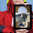 Man showing Dubrovnik in Croatia on tablet. Travel. — Stockfoto