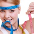 Sporty fit woman with measure tapes. Time for diet slimming. — Stock Photo #43338483