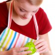 Housewife or chef in kitchen apron using apple timer isolated — ストック写真