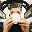 Woman drinking coffee tea in hair beauty salon. By hairdresser. — Stock Photo