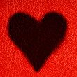 Valentine's day card. Heart love symbol on red leather background — Stock Photo #43338849