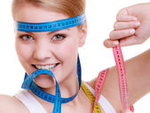 Sporty fit woman with measure tapes. Time for diet slimming. — Stock Photo