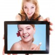 Girl showing woman with cream on tablet. Skin care — Stock Photo