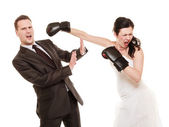 Wedding couple. Bride boxing groom. Conflict. — Stock Photo