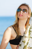 Summer vacation. Girl in bikini standing on beach — Stock Photo