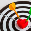 Black white target with two darts in heart love symbol as bullseye — Stock Photo #43648939