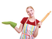 Housewife kitchen apron holds rolling pin showing copy space isolated — Stock Photo