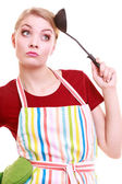 Funny housewife or cook chef in colorful kitchen apron with ladle — Stock Photo