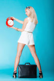 Woman with suitcase red clock. Travel time management concept. — Stock Photo