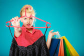 Pinup girl buying clothes black skirt. Sale retail — Stock Photo