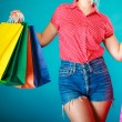 Pinup girl with shopping bags buying clothes dress — Stock Photo #44043941