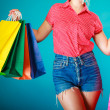 Pinup girl with shopping bags buying clothes dress — Stock Photo