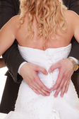 Wedding couple. Male hands making heart shape love — Stock Photo