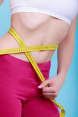 Diet. Fitness woman fit girl with measure tape measuring her waist — Stock Photo