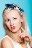 Portrait beautiful blonde woman pinup girl retro style on blue — Stock Photo