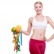 Sporty fit woman with measure tapes fruits. Time for diet slimming. — Stock Photo #44634743