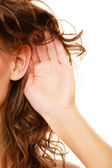 Part of head woman with hand to ear listening — Stock Photo