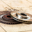 Auto in service. New and old front brake disks for modern car. — Stock Photo #45051599