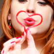 Redhaired girl holding red heart love blowing kiss. Valentines day. — Stock Photo #45051753