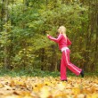 Woman running in autumn forest.  Female runner training. — Stock Photo #45052089
