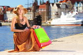 Stylish shopper woman in old town Gdansk — Stock Photo