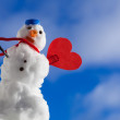 Little happy christmas snowman red heart love symbol outdoor. Winter. — Stock Photo #45128325