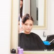 Woman dying hair in hairdressing beauty salon. By hairstylist. — Stock Photo #45129783