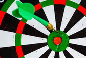 Bullseye. Black and white target with dart as sport background — Foto de Stock